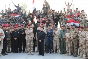 Le Premier Ministre Irakien Heydar Abadi lève le drapeau irakien dans le ciel de Mossoul et a annoncé la libération totale de Mossoul2