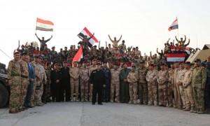 Le Premier Ministre Irakien Heydar Abadi lève le drapeau irakien dans le ciel de Mossoul et a annoncé la libération totale de Mossoul3