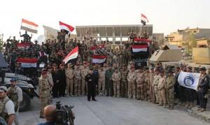 Le Premier Ministre Irakien Heydar Abadi lève le drapeau irakien dans le ciel de Mossoul et a annoncé la libération totale de Mossoul4