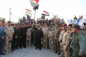 Le Premier Ministre Irakien Heydar Abadi lève le drapeau irakien dans le ciel de Mossoul et a annoncé la libération totale de Mossoul6