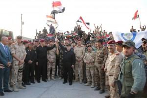 Le Premier Ministre Irakien Heydar Abadi lève le drapeau irakien dans le ciel de Mossoul et a annoncé la libération totale de Mossoul7