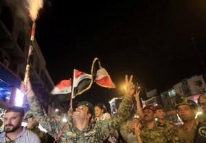les habitants de Bagdad célèbrent la libération de Mossoul... Que voulez-vous dire à cette occasion 2