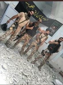 les lâches soldats saoudiens s'exhibent fièrement dans une Husseiniya Al Awamiyah2