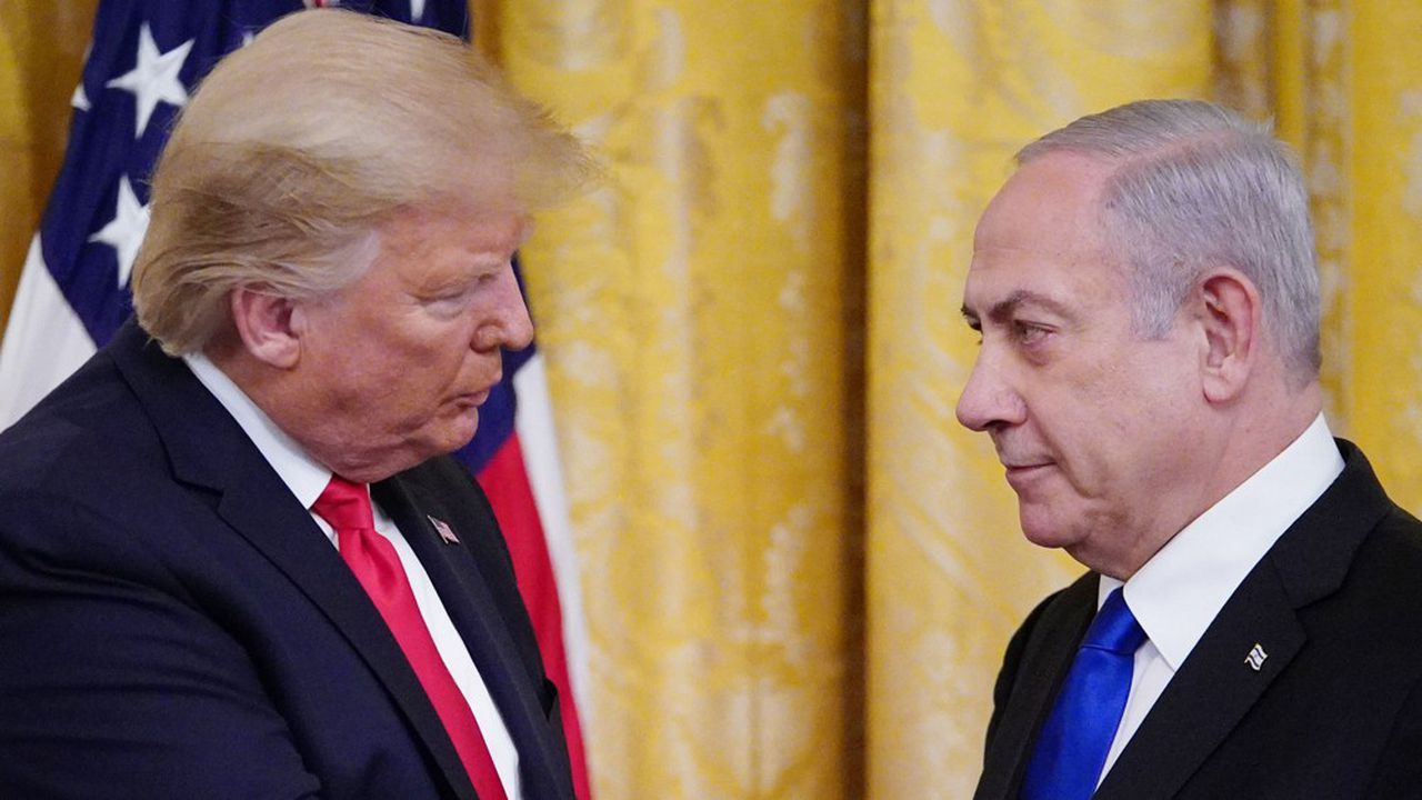 "US President Donald Trump and Israel's Prime Minister Benjamin Netanyahu take part in an announcement of Trump's Middle East peace plan in the East Room of the White House in Washington, DC on January 28, 2020. - Trump declared that Israel was taking a ""big step towards peace"" as he unveiled a plan aimed at solving the Israeli-Palestinian conflict. ""Today, Israel takes a big step towards peace,"" Trump said, standing alongside Netanyahu as he revealed details of the plan already emphatically rejected by the Palestinians. (Photo by MANDEL NGAN / AFP)"